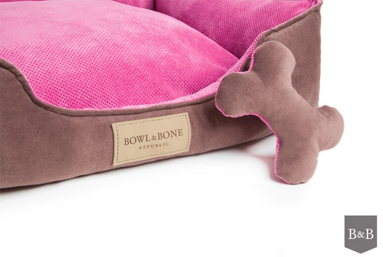 Classic pink bolster bed