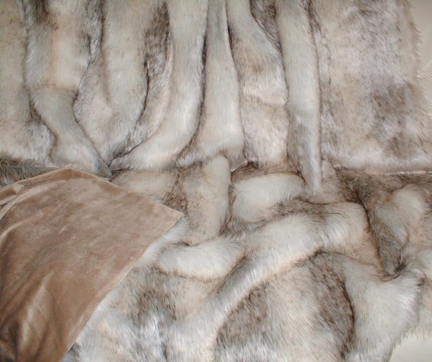 A subtle mix of cream, beige and grey faux fur throw