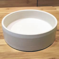 Cream pottery round dog bowl