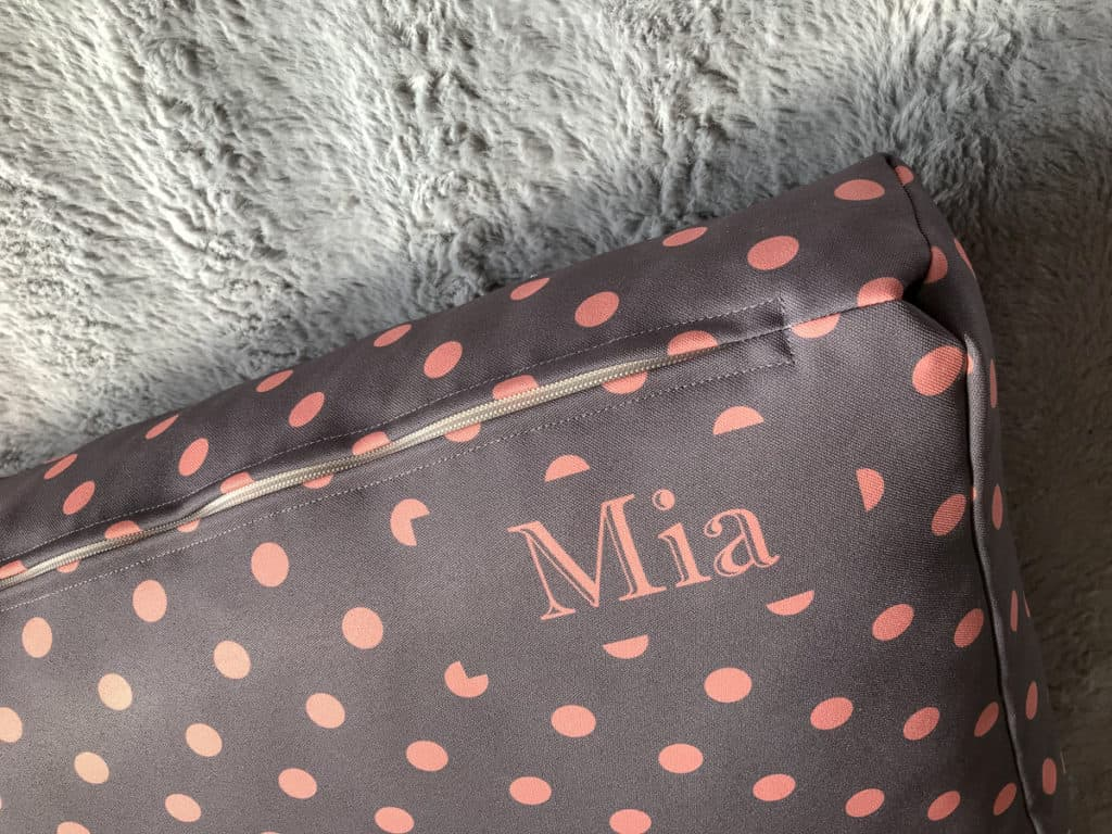 Slate grey and coral spotty dog cushion bed